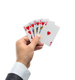 Royal flush in hearts in hand Royalty Free Stock Photo