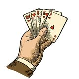 Royal flush in hearts. Male hand holding a game card. Royalty Free Stock Photos