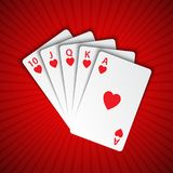 A royal flush of hearts on red background, winning hands of poke Royalty Free Stock Image