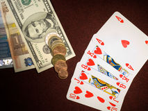 Royal flush and money on the table Stock Images