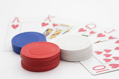 Royal Flush with pile of poker chips. On white background Royalty Free Stock Image