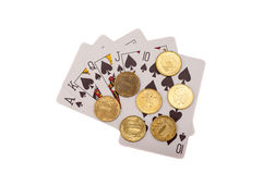 Royal flush. Playing cards and coins Royalty Free Stock Images