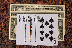 Royal flush playing cards. With dollar money Royalty Free Stock Photography