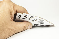 Royal flush playing cards in hand Royalty Free Stock Images