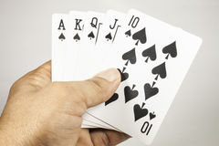 Royal flush playing cards in hand Stock Image