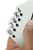 Royal flush playing cards in hand. Stock Photo