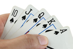 Royal flush playing cards in hand. Royalty Free Stock Images