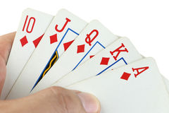 Royal flush playing cards in hand. Stock Photography