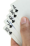 Royal flush playing cards in hand. Royalty Free Stock Photography