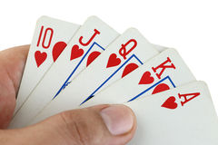 Royal flush playing cards in hand. Royalty Free Stock Photos