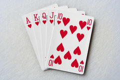 Royal flush. Playing cards on a white surface Royalty Free Stock Photos