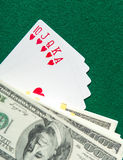 Royal Flush poker card sequence with currency Royalty Free Stock Images