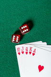 Royal Flush poker card sequence near dices Stock Photography