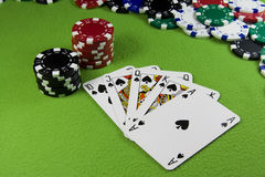 Royal flush in poker cards, chips table. Royal flush in poker cards, chips green table Royalty Free Stock Photos