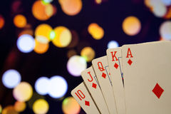 Royal flush poker cards combination on blurred background casino luck fortune. Royal flush poker cards combination  casino luck fortune Royalty Free Stock Photos