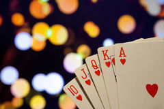 Royal flush poker cards combination on blurred background casino luck fortune. Royal flush poker cards combination  casino luck fortune Royalty Free Stock Image