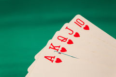 Royal flush poker cards combination on blurred background casino luck fortune. Royal flush poker cards combination  casino luck fortune Stock Images