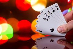 Royal flush poker cards combination on blurred background casino luck fortune card game. D Royalty Free Stock Photography
