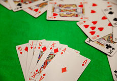 Royal flush poker cards combination on green background casino game fortune luck Royalty Free Stock Photos