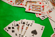 Royal flush poker cards combination on green background casino game fortune luck Royalty Free Stock Photography