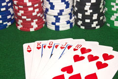 Royal Flush and Poker Chips. A winning poker hand of a royal flush with stacks of poker chips stock images
