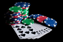 Royal flush and poker chips. On a black background Stock Photo