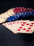 Royal Flush and poker chips, Split toning, retro look. Stock Photo