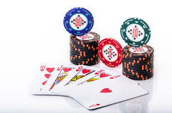 Royal Flush with poker chips. Royal Flush with stacked poker chips on white background Stock Images