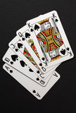 Royal flush poker combination. Closeup of playing cards: king, queen, jack, ten and ace Royalty Free Stock Photography