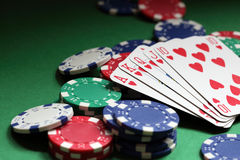 Royal flush poker hand. Winning hand in poker royal flush with gambling chips Royalty Free Stock Photo