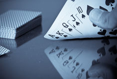 Royal Flush Poker Hand. With Reflection stock photo