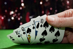 Royal flush poker. A poker player shows his hand which is a royal flush in a casino. Winning streak Stock Photos