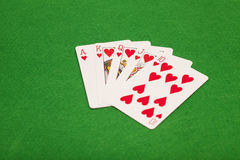 Royal flush poker playing cards on green felt background Royalty Free Stock Photos