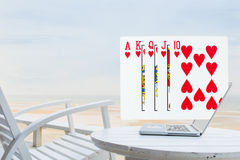 Royal Flush pouring out from laptop Royalty Free Stock Photography