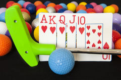 Royal Flush with Putter and Golf Balls Stock Images