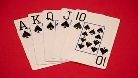 Royal flush on red background Royalty Free Stock Photo