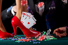 Royal flush in shoe. A royal flush of hearts in a red pump Royalty Free Stock Photos