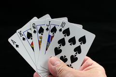 Royal Flush in Spades. Poker hand with a Royal Flush in spades on a black background Stock Photo