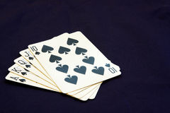Royal Flush in Spades. Royal flush poker hand showing spades on a black background Royalty Free Stock Images