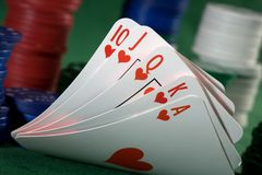 Royal flush of spades  and chips Stock Photo
