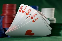Royal flush of spades  and chips Royalty Free Stock Photos