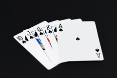Royal Flush of spades in poker cards game on a black background Royalty Free Stock Photo