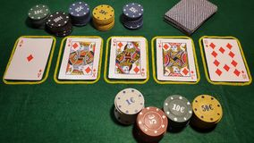Royal flush. Table poker game with cards and poker chips Royalty Free Stock Image