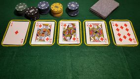Royal flush. Table poker game with cards and poker chips Stock Photos