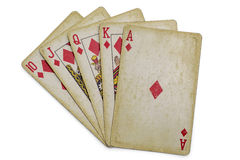 Royal flush. With vintage cards isolated on white Stock Images