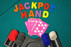Royal Flush is a winning hand in Poker. Jackpot Hand played on the Gaming Table Stock Photos