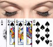 Royal flush. The woman got the best combination in poker. The peak royal flush. Beautiful eyes Royalty Free Stock Photography