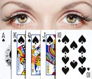 Royal flush. The woman got the best combination in poker. The peak royal flush. Beautiful eyes Stock Image