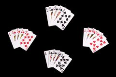 Royal Flushes. All four suits of royal flushes isolated Royalty Free Stock Photos