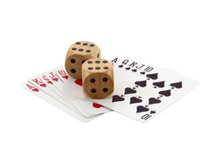 Royal Flushes in Spades and Hearts with Wooden Dice Royalty Free Stock Photography